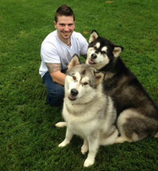 Evan with two Alaskan Malamutes